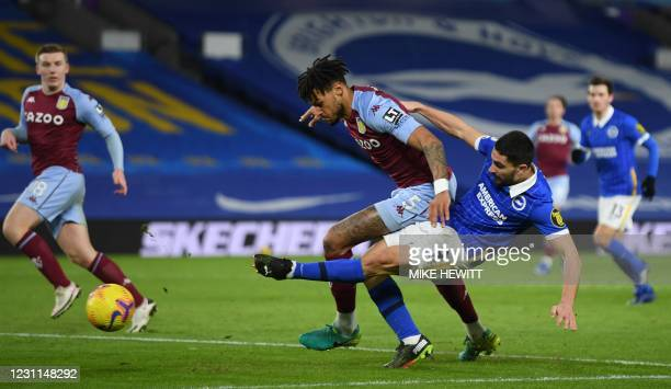 Aston Villa's English defender Tyrone Mings defends against Brighton's French striker Neal Maupay during the English Premier League football match...