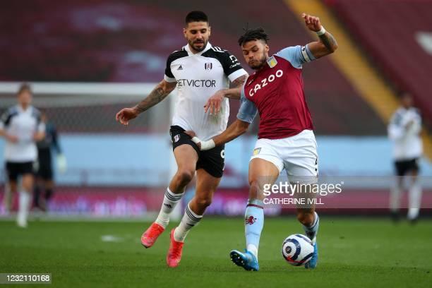Aston Villa's English defender Tyrone Mings vies for the ball against Fulham's Serbian striker Aleksandar Mitrovic during the English Premier League...