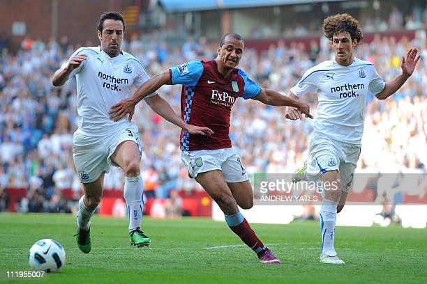Aston Villa's English forward Gabriel Agbonlahor vies with Newcastle United's Spanish defender Sanchez Jose Enrique and Newcastle United's...