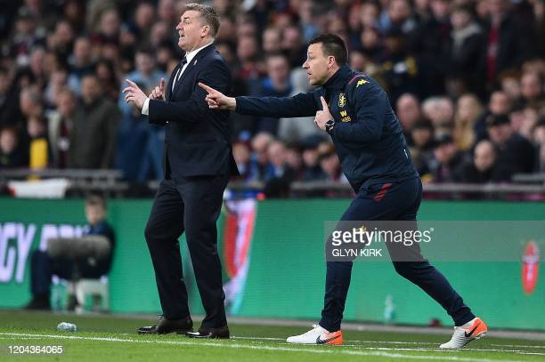 Aston Villa's English head coach Dean Smith and Aston Villa's English assistant manager John Terry shouts instructions from the touchline during the...
