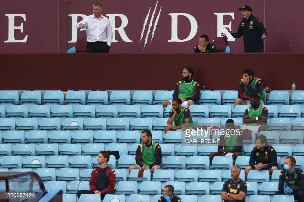 Aston Villa's English head coach Dean Smith and Aston Villa's English assistant manager John Terry , watch the match near Aston Villa replacement...