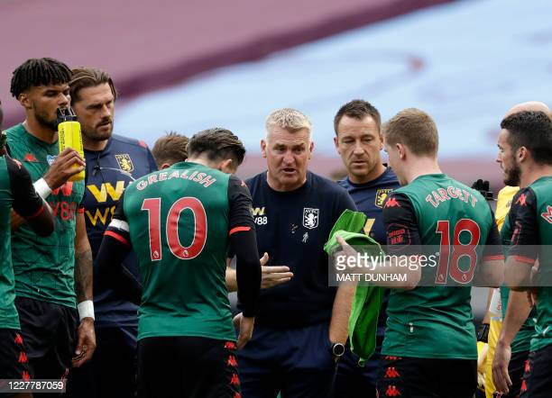 Aston Villa's English head coach Dean Smith and Aston Villa's English assistant manager John Terry talk to the players during a drinks break during...