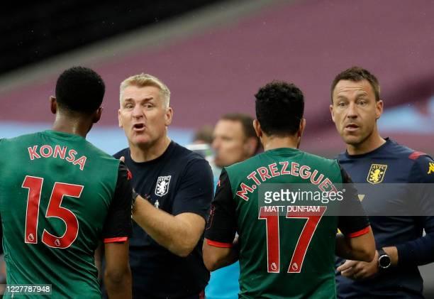 Aston Villa's English head coach Dean Smith and Aston Villa's English assistant manager John Terry talk to the players during the English Premier...