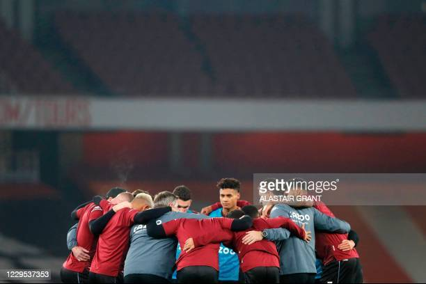 Aston Villa's English head coach Dean Smith and Aston Villa's English assistant coach John Terry huddle with the players ahead of the English Premier...