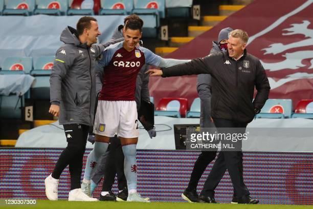 Aston Villa's English head coach Dean Smith and Aston Villa's English assistant coach John Terry speak with Aston Villa's Dutch striker Anwar El...