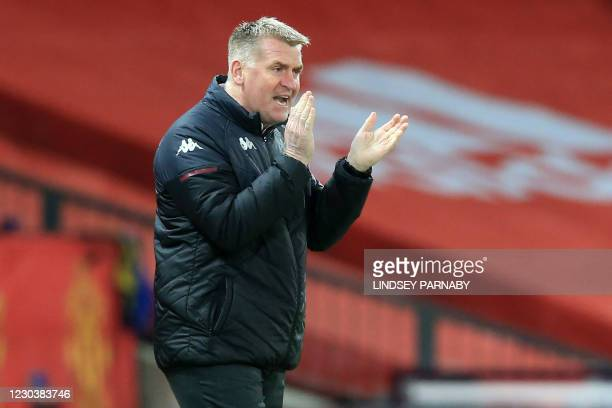 Aston Villa's English head coach Dean Smith gestures on the touchline during the English Premier League football match between Manchester United and...