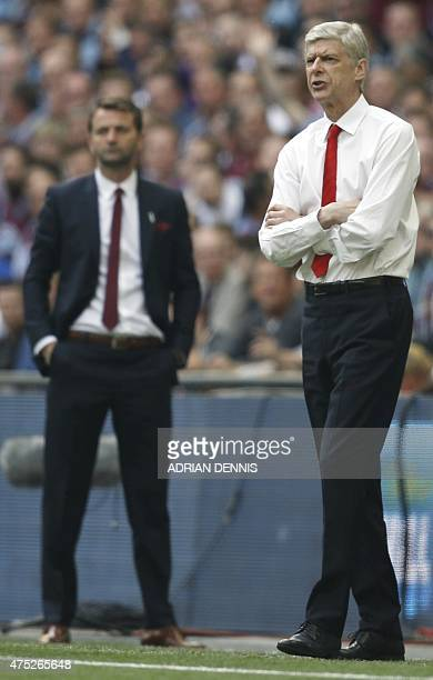 Aston Villa's English manager Tim Sherwood and Arsenal's French manager Arsene Wenger look on during the FA Cup final football match between Aston...