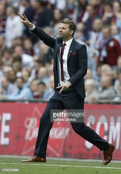 Aston Villa's English manager Tim Sherwood gestures during the FA Cup final football match between Aston Villa and Arsenal at Wembley stadium in...