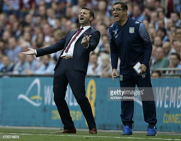 Aston Villa's English manager Tim Sherwood reacts during the FA Cup final football match between Aston Villa and Arsenal at Wembley stadium in London...