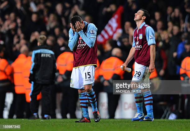 Aston Villa's English midfielder Ashley Westwood and Irish defender Enda Stevens react at the final whistle after losing a two goal lead in the...