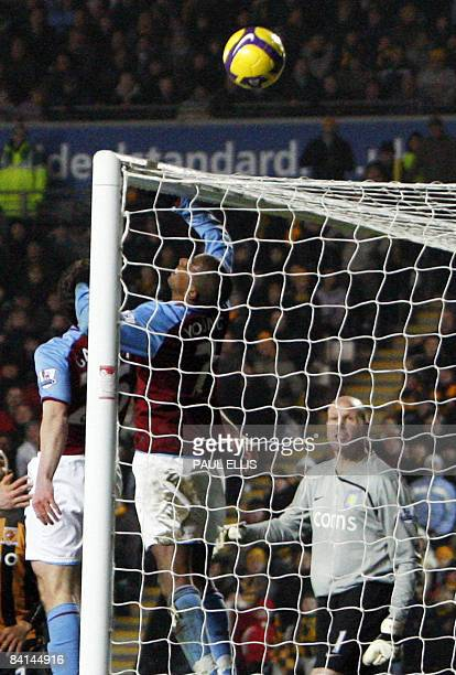 Aston Villa's English midfielder Ashley Young puts his hand towards the ball against Hull City during their English Premier League football match at...