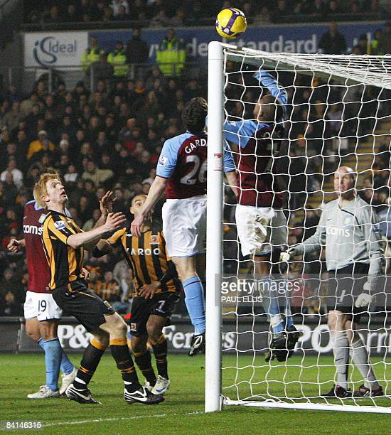 Aston Villa's English midfielder Ashley Young puts his hand towrads the ball against Hull City during their English Premier League football match at...
