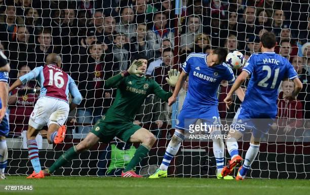 Aston Villa's English midfielder Fabian Delph scores his goal past Chelsea's Czech goalkeeper Petr Cech and Chelsea's English defender John Terry...