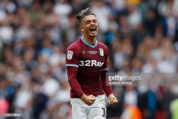 Aston Villa's English midfielder Jack Grealish celebrates after winning the English Championship play-off final football match between Aston Villa...