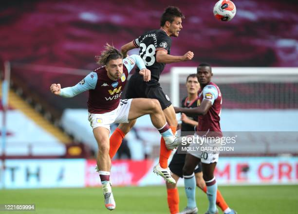 Aston Villa's English midfielder Jack Grealish jumps for the ball against Chelsea's Spanish defender Cesar Azpilicueta during the English Premier...