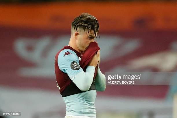 Aston Villa's English midfielder Jack Grealish reacts at the end of the English Premier League football match between Aston Villa and Manchester...