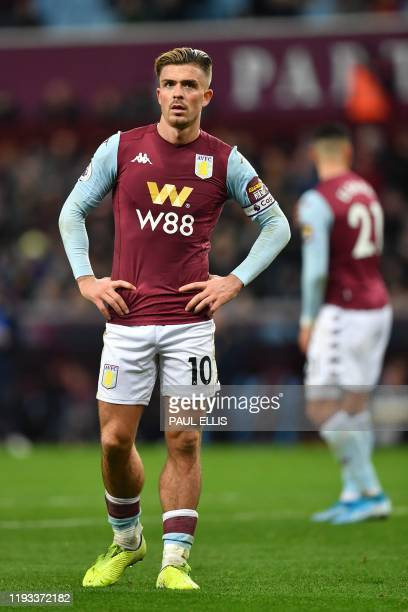 Aston Villa's English midfielder Jack Grealish reacts during the English Premier League football match between Aston Villa and Manchester City at...