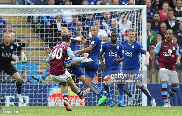 Aston Villa's English midfielder Jack Grealish shoots to score the opening goal of the English Premier League football match between Leicester City...