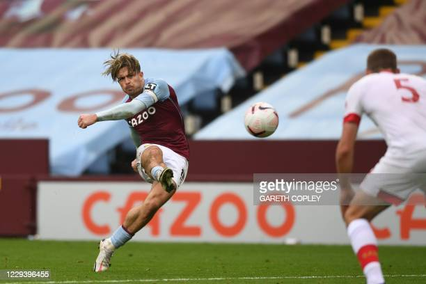 Aston Villa's English midfielder Jack Grealish shoots to score their third goal during the English Premier League football match between Aston Villa...