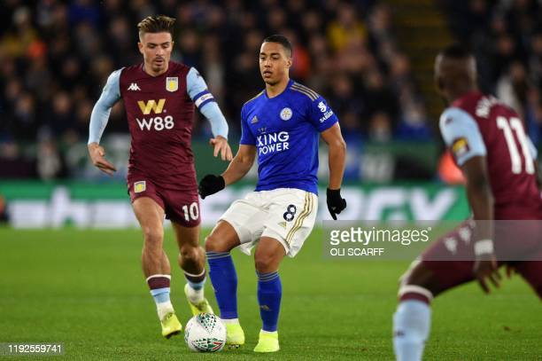 Aston Villa's English midfielder Jack Grealish vies with Leicester City's Belgian midfielder Youri Tielemans during the English League Cup semifinal...