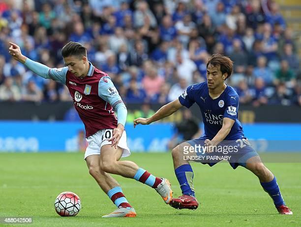 Aston Villa's English midfielder Jack Grealish vies with Leicester City's Japanese striker Shinji Okazaki during the English Premier League football...