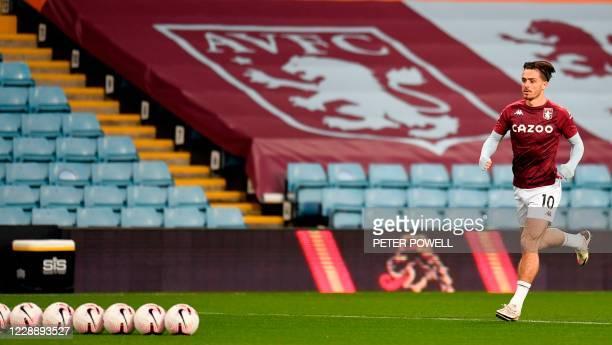 Aston Villa's English midfielder Jack Grealish warms up for the English Premier League football match between Aston Villa and Liverpool at Villa Park...