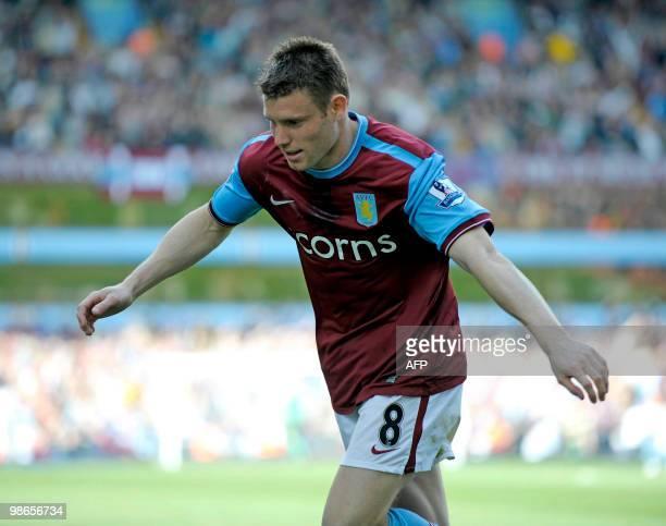 Aston Villa's English midfielder James Milner celebrates scoring his goal during the English Premier League football match between Aston Villa and...