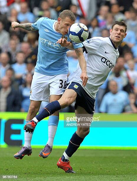 Aston Villa's English midfielder James Milner vies with Manchester City's Welsh striker Craig Bellamy during the English Premier League football...