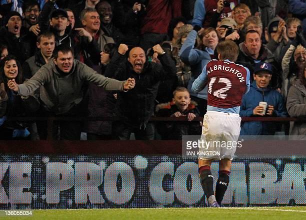 Aston Villa's English midfielder Marc Albrighton celebrates scoring his goal, Albrighton struck in the 54th minute to cancel out Robin van Persie's...