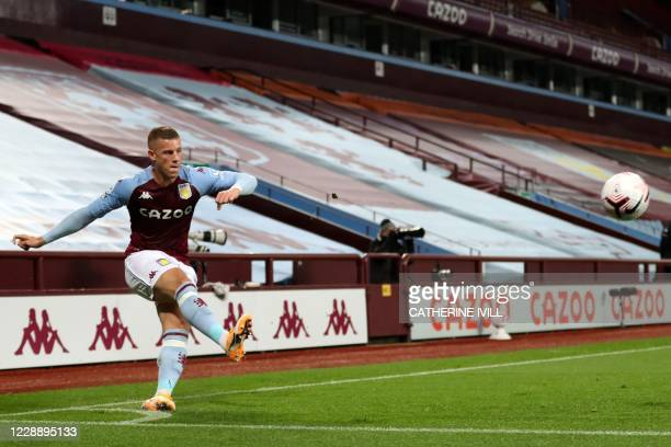 Aston Villa's English midfielder Ross Barkley takes a corner during the English Premier League football match between Aston Villa and Liverpool at...