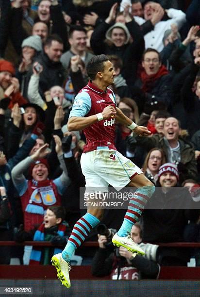 Aston Villa's English midfielder Scott Sinclair celebrates scoring their second goal during the FA Cup fifth round football match between Aston Villa...