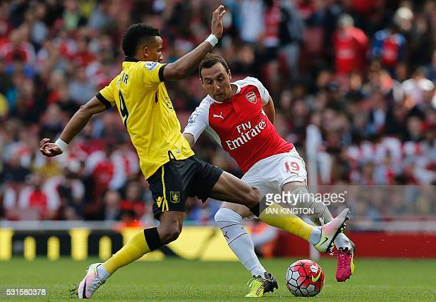 Aston Villa's English midfielder Scott Sinclair vies with Arsenal's Spanish midfielder Santi Cazorla during the English Premier League football match...
