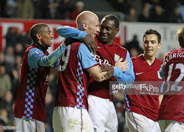 Aston Villa's English striker Emile Heskey celebrates scoring his goal with Welsh defender James Collins during the English Premier League football...