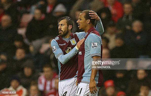 Aston Villas English striker Gabriel Agbonlahor is congratulated by Aston Villas Spanish defender Antonio Luna after scoring the opening goal during...