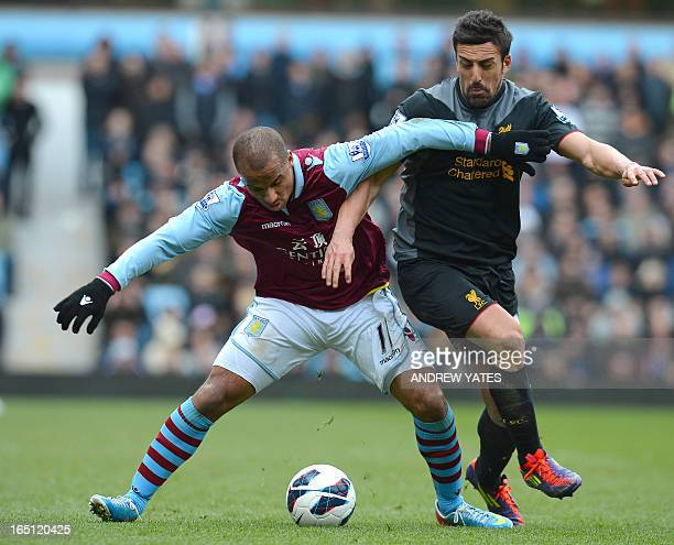 Aston Villa's English striker Gabriel Agbonlahor vies with Liverpool's Spanish defender Jose Enrique during the English Premier League football match...