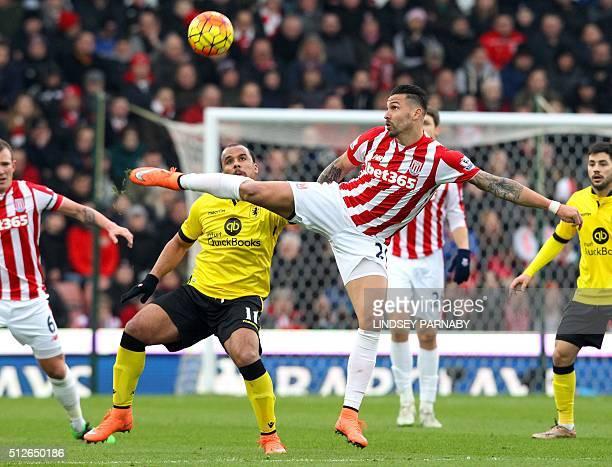 Aston Villa's English striker Gabriel Agbonlahor vies with Stoke City's US defender Geoff Cameron during the English Premier League football match...