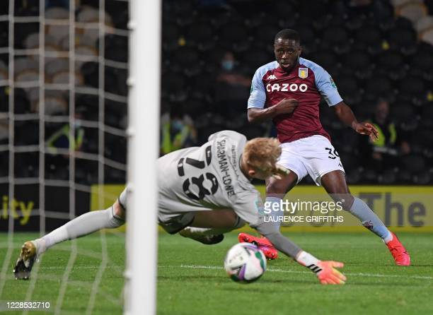 Aston Villa's English striker Keinan Davis scores his team's third goal during the English League Cup second round football match between Burton...