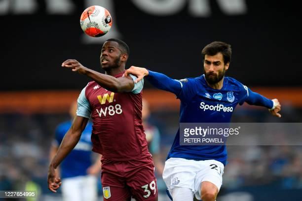 Aston Villa's English striker Keinan Davis vies with Everton's Portuguese midfielder André Gomes during the English Premier League football match...