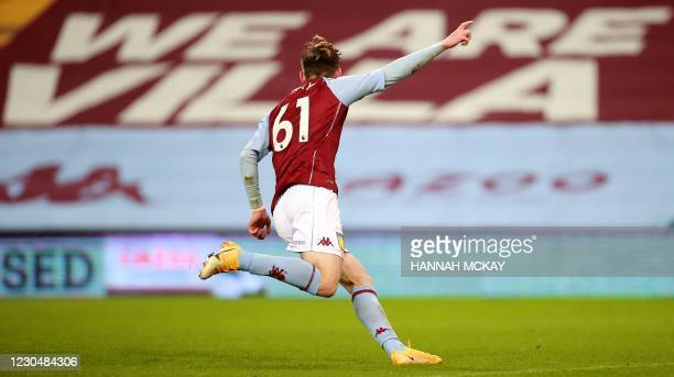 Aston Villa's English striker Louie Barry celebrates after scoring the equalising goal during the English FA Cup third round football match between...