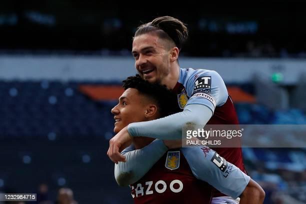 Aston Villa's English striker Ollie Watkins celebrates scoring his team's second goal with Aston Villa's English midfielder Jack Grealish during the...