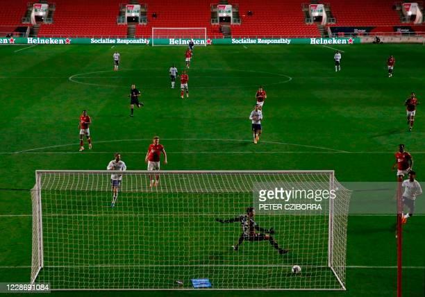 Aston Villa's English striker Ollie Watkins scores his team's third goal past Bristol City's Irish goalkeeper Max O'Leary during the English League...