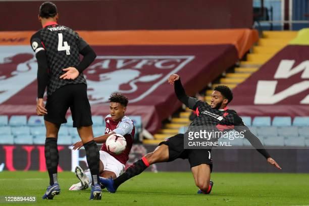 Aston Villa's English striker Ollie Watkins shoots past Liverpool's English defender Joe Gomez to score their second goal during the English Premier...