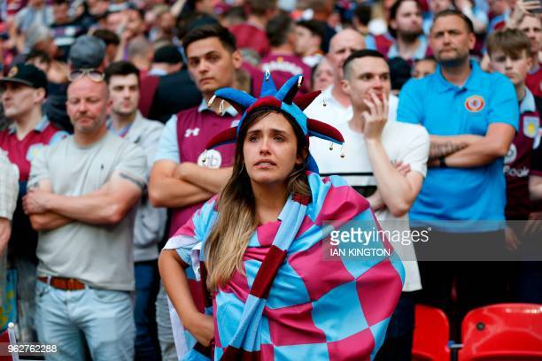 Aston Villa's fans react to their defeat after the English Championship playoff final football match between Aston Villa and Fulham at Wembley...
