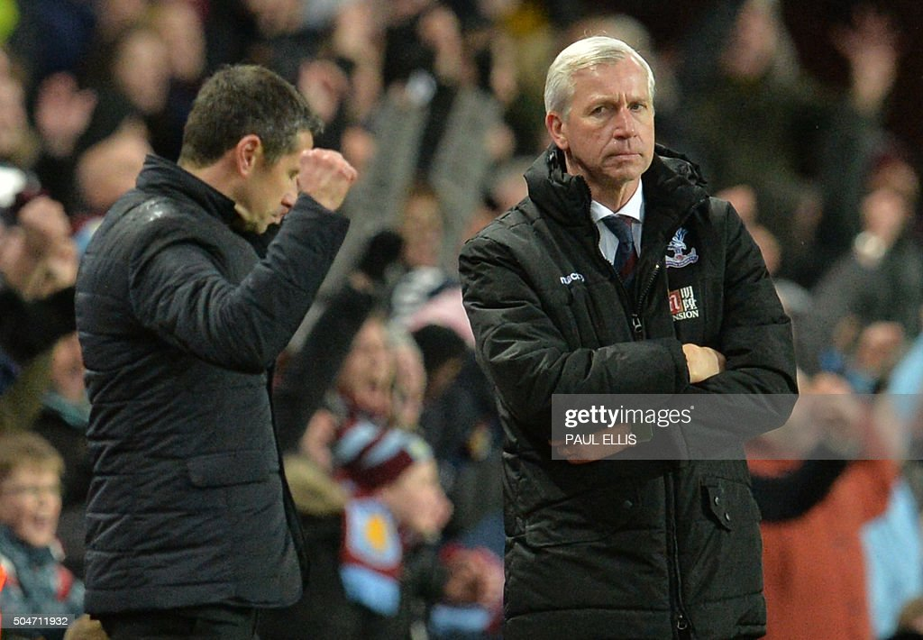 Aston Villa's French manager Remi Garde (L) celebrates by Crystal Palace's English manager Alan Pardew after winning the English Premier League football match between Aston Villa and Crystal Palace at Villa Park in Birmingham, central England on January 12, 2016. AFP PHOTO / PAUL ELLIS USE. No use with unauthorized audio, video, data, fixture lists, club/league logos or 'live' services. Online in-match use limited to 75 images, no video emulation. No use in betting, games or single club/league/player publications. / AFP / PAUL