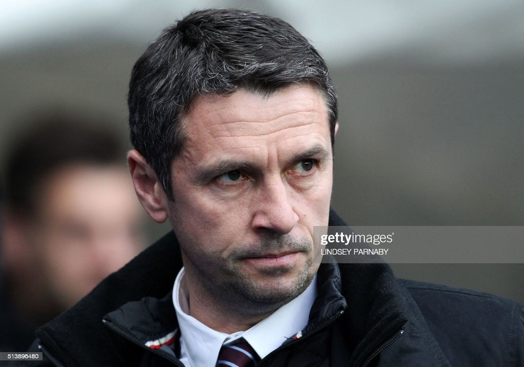 Aston Villa's French manager Remi Garde watches his players during the English Premier League football match between Manchester City and Aston Villa at the Etihad Stadium in Manchester, north west England, on March 5, 2016. Manchester City won the match 4-0. / AFP / LINDSEY PARNABY / RESTRICTED TO EDITORIAL USE. No use with unauthorized audio, video, data, fixture lists, club/league logos or 'live' services. Online in-match use limited to 75 images, no video emulation. No use in betting, games or single club/league/player publications. /
