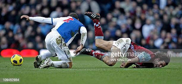 Aston Villa's French midfielder Robert Pires vies with Blackburn Rovers' US midfielder Jermaine Jones during the English Premier League football...