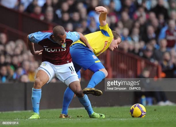 Aston Villa's Gabriel Agbonlahor and Stoke City's Glenn Whelan battle for the ball