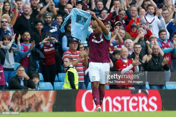 Aston Villa's Gabriel Agbonlahor celebrates his goal by holding up a tshirt in support of Wolves player Carl Ikeme's cancer battle during the Sky Bet...