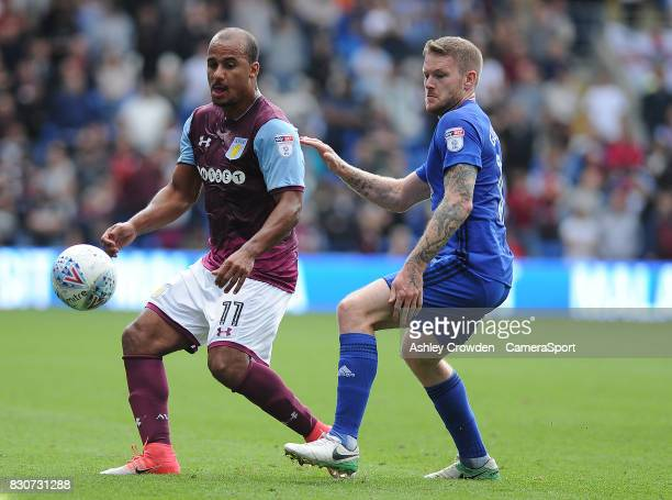 Aston Villa's Gabriel Agbonlahor vies for possession with Cardiff City's Aron Gunnarsson during the Sky Bet Championship match between Cardiff City...