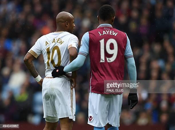 Aston Villa's Ghanaian striker Jordan Ayew marks his brother Swansea City's Ghanaian striker Andre Ayew at a corner during the English Premier League...